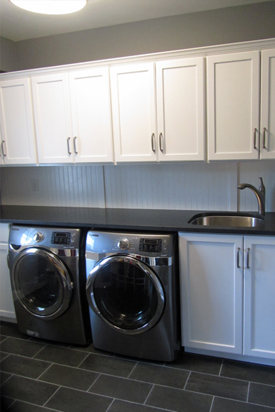 In a mudroom laundry functionality rules design build for Under cabinet washer and dryer